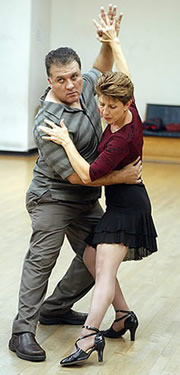 Juan Avendaño and Sue Lindenberg practice a dance move during a tango dancing class at Dance Unlimited in Morgan Hill.