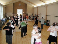 Students dancing the tango at a workshop taught by Jorge Torres